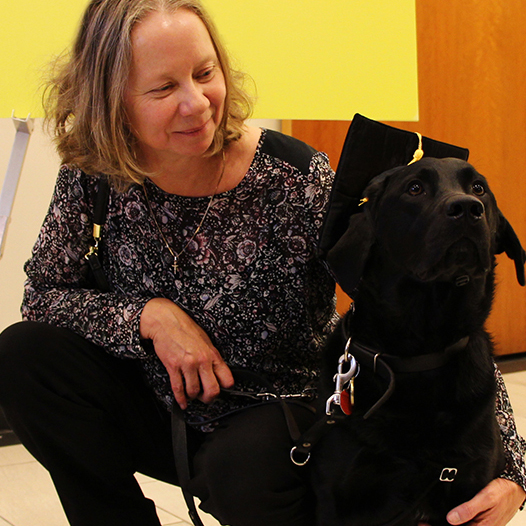 Image of Cindy Shone and her guide dog, Barney