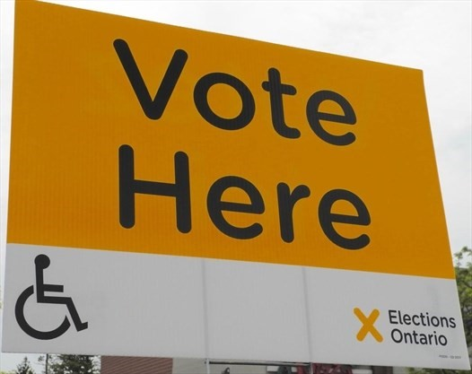 Vote Here sign with wheelchair symbol and Elections Ontario logo.