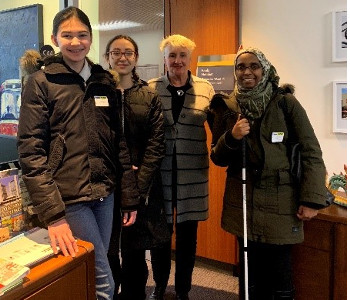 Ward 14 Toronto-Danforth Councillor Paula Fletcher with students Dalia Golovco and Maddie Dick, and Ramla Abukar, Coordinator, Advocacy and Engagement, CNIB posing for a photo.