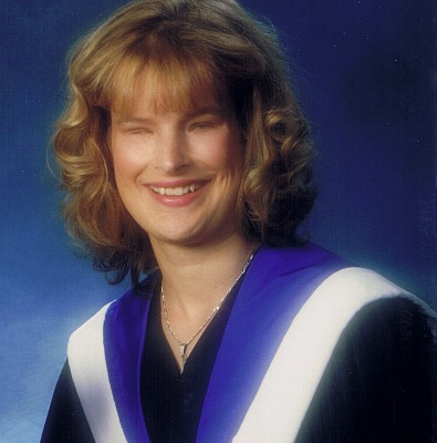 Holly Bartlett wearing a graduation gown, smiling