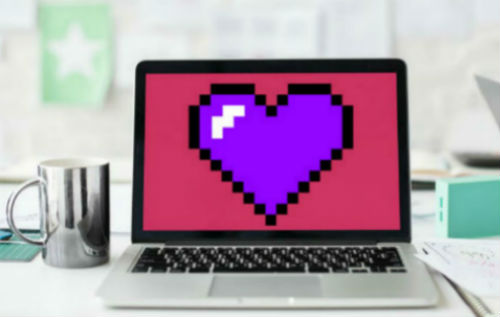 Laptop computer with large purple heart on the screen