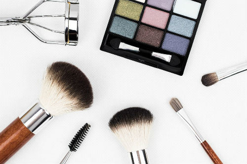 Makeup products strewn about