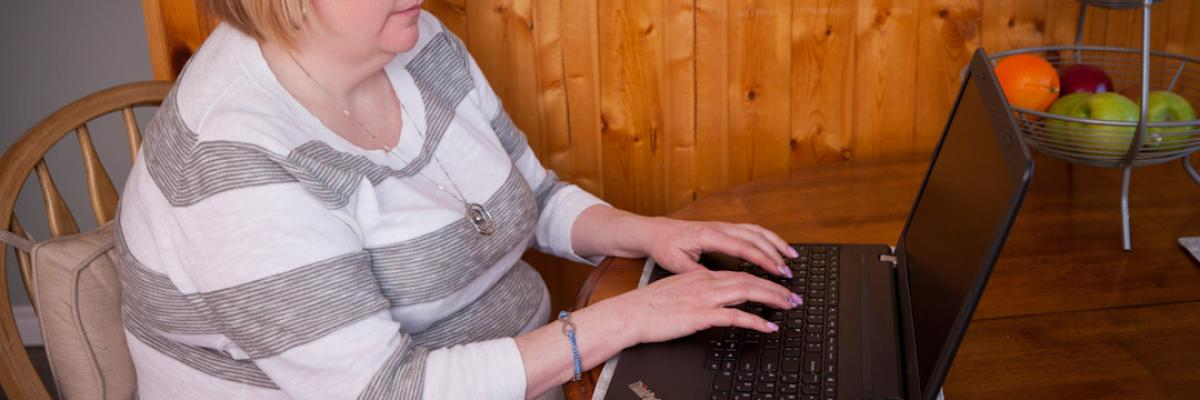 Woman using a computer with screen reader
