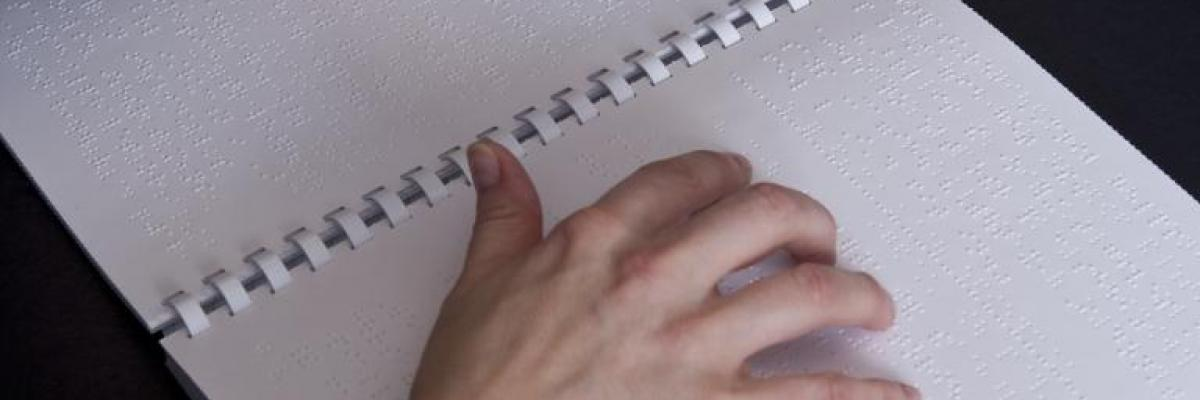 a hand reading braille