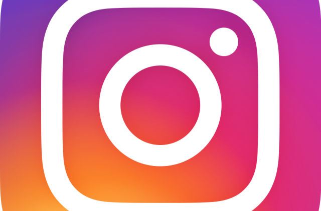 The Instagram logo: a white camera outline with a gradient yellow, orange, pink and purple background.