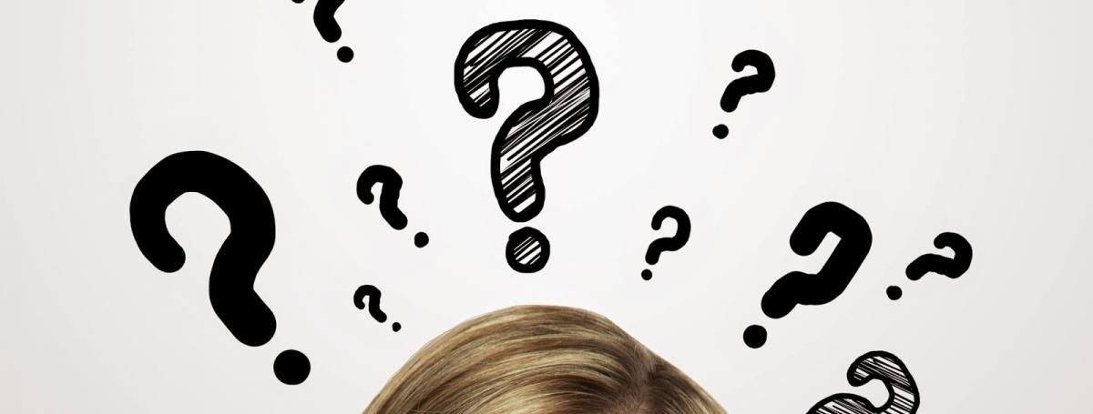 Photo of the top part of a woman's face with an illustration of question marks floating above her head.
