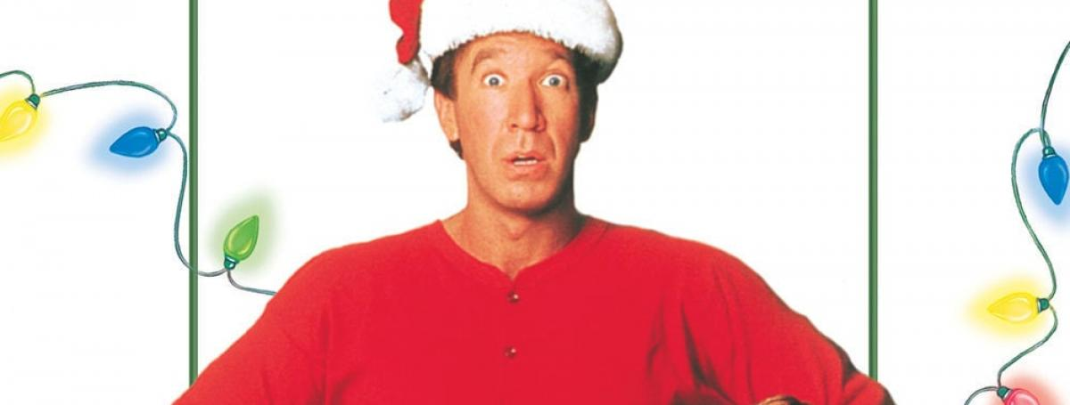 "The movie poster for ""The Santa Clause."" Tim Allen wears a red jumpsuit and a Santa hat."