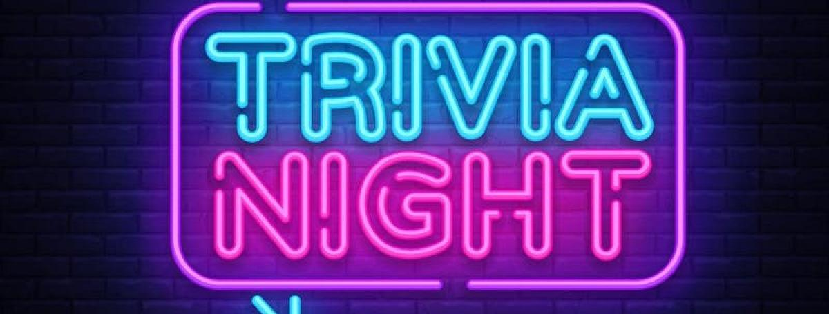 "A bar-style neon bulb light sign that reads ""Trivia Night"""