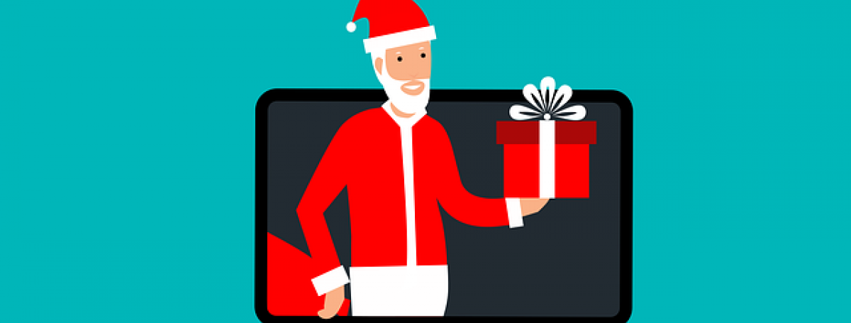 A graphic art illustration of a laptop computer screen. Santa Claus is popping out of the computer and holding a gift in his left hand.