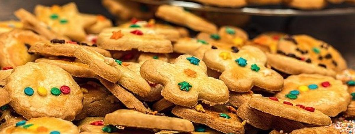 A large batch of delicious cookies decorated with holiday sprinkles.