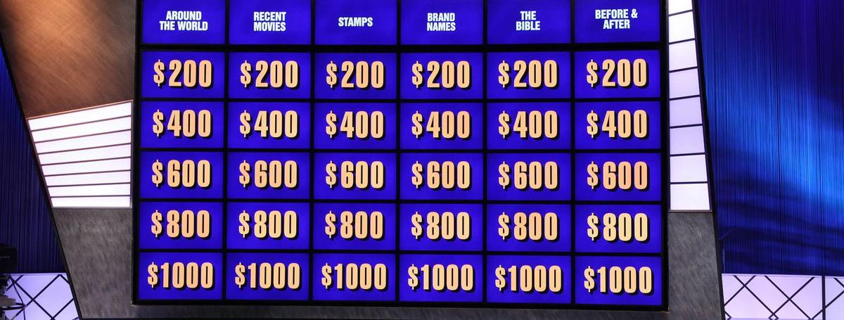 The  jeopardy question board with categories and multiple dollar amounts displayed.