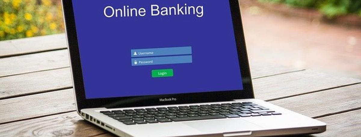 A laptop computer displays an online banking module.