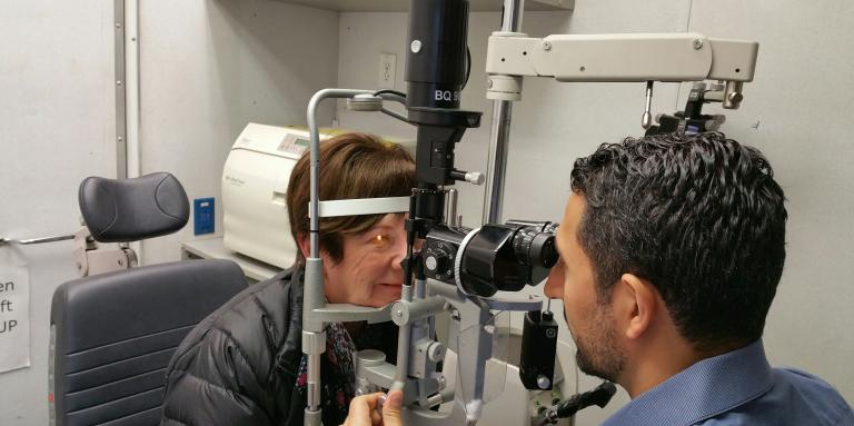 A woman getting her eyes checked by an optometrist