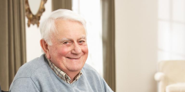 Elderly man smiling into camera