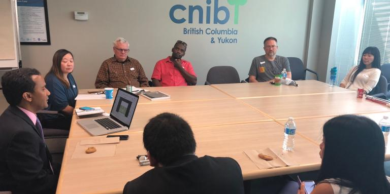 CNIB's Kevin Shaw gives a presentation at the Vancouver office.