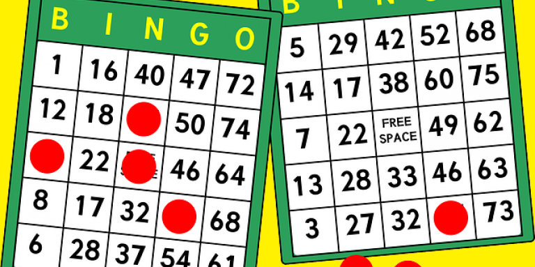 An illustration of a bingo card with numbers and red playing chips.