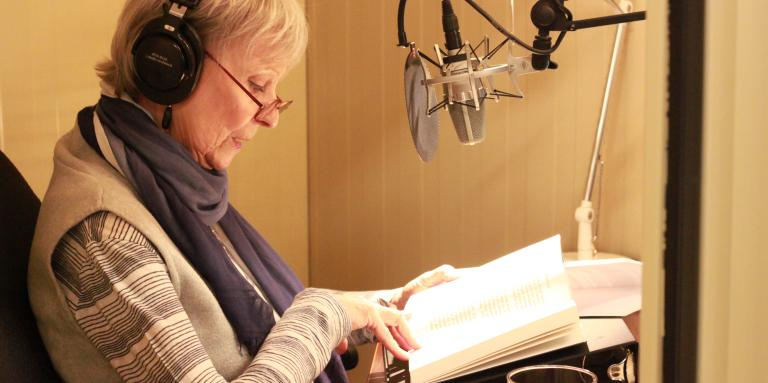 Celine Garneau, reading from a book in one of CNIB's recording studios.