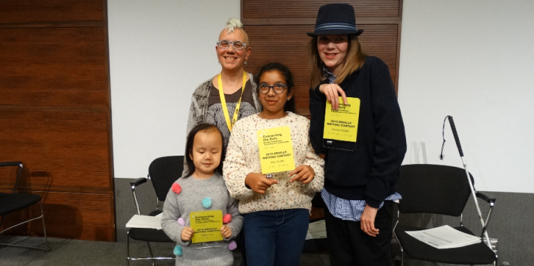 Winners from the 2019 Braille Creative Writing Contest Kelsey, Zara and Zachary pose for a photo with Karen Brophey. They are holding their awards