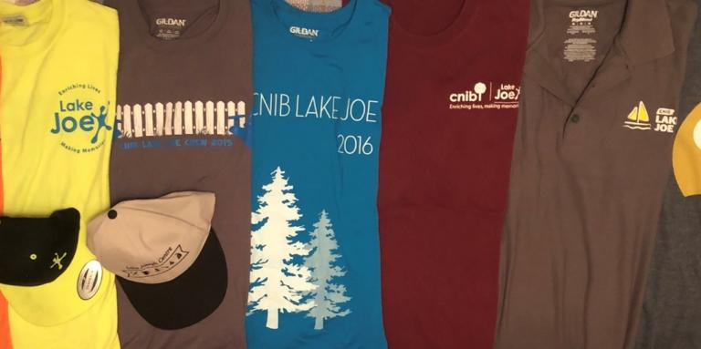 Seven Colourful CNIB Lake Joe staff t-shirts from over the years.