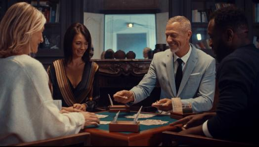 two men and two women playing bridge